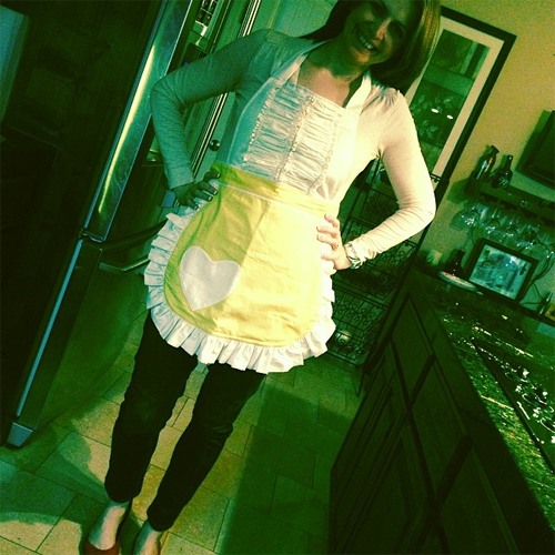 Heidi St. John in a yellow Sugar Baby Apron